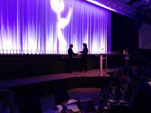 Taylor receiving award.